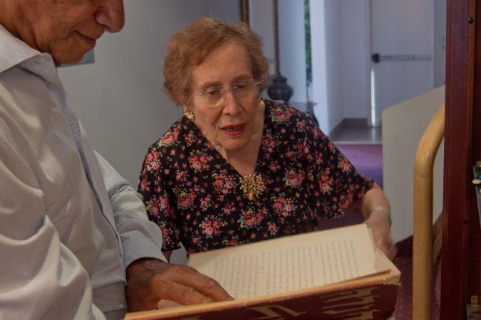 Jamil Heardoon and Alice Aboody examine an Iraqi Jewish text at Bene Naharayim.