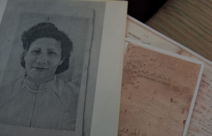 A photograph of Penina Offrey's mother and copy of her passport, which let her leave Iraq but stripped her of citizenship.