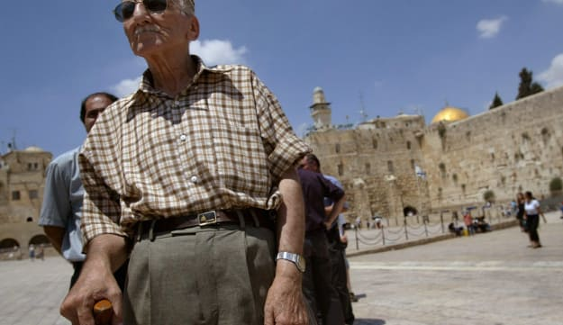 Ezra Levi, 82, left, during a visit to Jerusalem's Old City, July 2003. Levi was one of six elderly Iraqi Jews brought from Iraq in a secretive airlift earlier that month.
