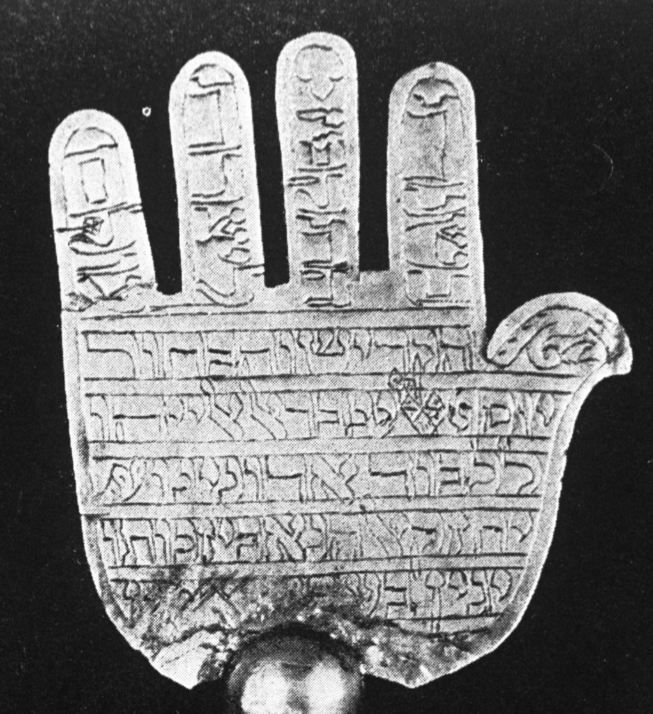 B&W image of a hand with written inscription on it